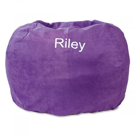 Personalized Purple Bean Bag Chair Your child's very own bean bag chair provides a fun, comfortable place to relax, anywhere in your home. Cover is micro suede with a side pocket for storing a toy, a small book, or anything your child deems essential. Beanbag measures about 30  across and is perfect for looking at books, napping, watching TV, or thinking the deepest thoughts. The cover slips off for washing with mild soap and water; spot cleaning is recommended. Inside, the shredded foam is safely enclosed in a refillable inner bag with over-locking seams. No worries about messy escaping beans! Recommended for ages 2-6. Made in the USA. At no additional cost, you can have your child's name embroidered on the cover. Specify name up to 10 characters. *This item requires an Oversize Fee. The charge is in addition to regular shipping and handling fees and will be indicated in your Shopping Cart. This item cannot be sent using expedited delivery. Standard shipping only. Expedited shipping not available. Allow at least 2 weeks for delivery unless otherwise noted. Cannot be sent outside the 48 contiguous states, or to P.O. Box, APO/FPO, or foreign addresses.