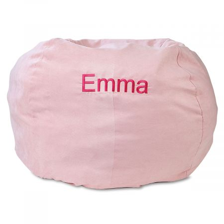Personalized Pink Bean Bag Chair Your child's very own bean bag chair provides a fun, comfortable place to relax, anywhere in your home. Cover is micro suede with a side pocket for storing a toy, a small book, or anything your child deems essential. Beanbag measures about 30  across and is perfect for looking at books, napping, watching TV, or thinking the deepest thoughts. The cover slips off for washing with mild soap and water; spot cleaning is recommended. Inside, the shredded foam is safely enclosed in a refillable inner bag with over-locking seams. No worries about messy escaping beans! Recommended for ages 2-6. Made in the USA. At no additional cost, you can have your child's name embroidered on the cover. Specify name up to 10 characters. *This item requires an Oversize Fee. The charge is in addition to regular shipping and handling fees and will be indicated in your Shopping Cart. This item cannot be sent using expedited delivery. Standard shipping only. Expedited shipping not available. Allow at least 2 weeks for delivery unless otherwise noted. Cannot be sent outside the 48 contiguous states, or to P.O. Box, APO/FPO, or foreign addresses.