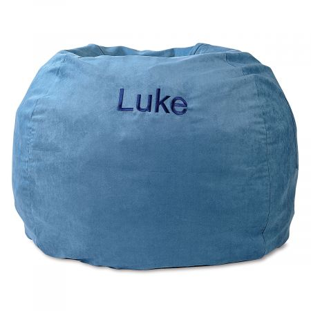 Personalized Blue Bean Bag Chair Your child's very own bean bag chair provides a fun, comfortable place to relax, anywhere in your home. Cover is micro suede with a side pocket for storing a toy, a small book, or anything your child deems essential. Beanbag measures about 30  across and is perfect for looking at books, napping, watching TV, or thinking the deepest thoughts. The cover slips off for washing with mild soap and water; spot cleaning is recommended. Inside, the shredded foam is safely enclosed in a refillable inner bag with over-locking seams. No worries about messy escaping beans! Recommended for ages 2-6. Made in the USA. At no additional cost, you can have your child's name embroidered on the cover. Specify name up to 10 characters. *This item requires an Oversize Fee. The charge is in addition to regular shipping and handling fees and will be indicated in your Shopping Cart. This item cannot be sent using expedited delivery. Standard shipping only. Expedited shipping not available. Allow at least 2 weeks for delivery unless otherwise noted. Cannot be sent outside the 48 contiguous states, or to P.O. Box, APO/FPO, or foreign addresses.