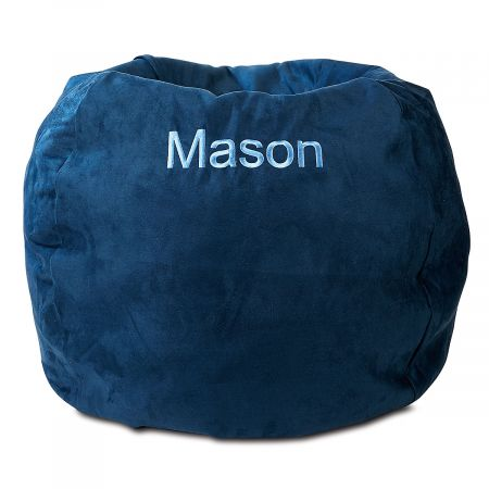 Navy Personalized Bean Bag Chair Your child's very own bean bag chair provides a fun, comfortable place to relax, anywhere in your home. Cover is micro suede with a side pocket for storing a toy, a small book, or anything your child deems essential. Beanbag measures about 30  across and is perfect for looking at books, napping, watching TV, or thinking the deepest thoughts. The cover slips off for washing with mild soap and water; spot cleaning is recommended. Inside, the shredded foam is safely enclosed in a refillable inner bag with over-locking seams. No worries about messy escaping beans! Recommended for ages 2-6. Made in the USA. At no additional cost, you can have your child's name embroidered on the cover. Specify name up to 10 characters. *This item requires an Oversize Fee. The charge is in addition to regular shipping and handling fees and will be indicated in your Shopping Cart. This item cannot be sent using expedited delivery. Standard shipping only. Expedited shipping not available. Allow at least 2 weeks for delivery unless otherwise noted. Cannot be sent outside the 48 contiguous states, or to P.O. Box, APO/FPO, or foreign addresses.