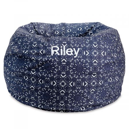 Personalized Blue Kaleidoscope Bean Bag Chair Your child's very own bean bag chair provides a fun, comfortable place to relax, anywhere in your home. Cover is micro suede with a side pocket for storing a toy, a small book, or anything your child deems essential. Beanbag measures about 30  across and is perfect for looking at books, napping, watching TV, or thinking the deepest thoughts. The cover slips off for washing with mild soap and water; spot cleaning is recommended. Inside, the shredded foam is safely enclosed in a refillable inner bag with over-locking seams. No worries about messy escaping beans! Recommended for ages 2-6. Made in the USA. At no additional cost, you can have your child's name embroidered on the cover. Specify name up to 10 characters. *This item requires an Oversize Fee. The charge is in addition to regular shipping and handling fees and will be indicated in your Shopping Cart. This item cannot be sent using expedited delivery. Standard shipping only. Expedited shipping not available. Allow at least 2 weeks for delivery unless otherwise noted. Cannot be sent outside the 48 contiguous states, or to P.O. Box, APO/FPO, or foreign addresses.