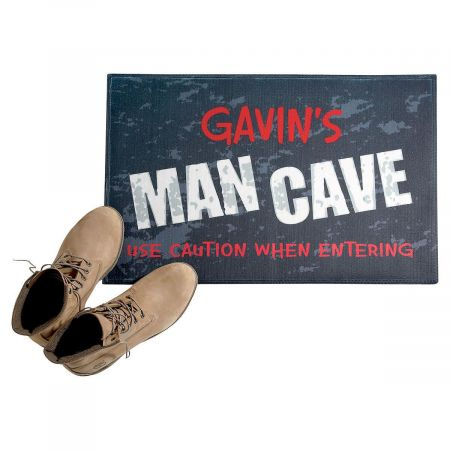 Man Cave Personalized Doormat When your guy needs some prehistoric privacy, this light-hearted floor mat will keep him smiling. 100% polyester, 27  x 18 . Machine wash, line dry. Non-slip backing. Specify up to 14 characters for name.