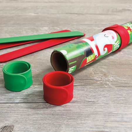 Silicone Holiday Red & Green Flip Wraps - Set of 6 With a slap, each flat, silicone-covered, 1 x 9  metal strip flips itself into a secure circle. Keeps gift wrap rolls, computer cables, and electrical cords neat & organized. 3 red and 3 green. Set of 6