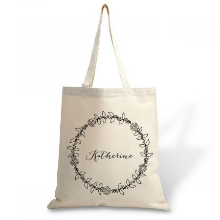 Personalized Wreath Name Canvas Tote Why settle for a plastic bag, when you can use this distinctively designed, eco-friendly alternativebeautifully embellished with the name you choose. Heavyweight cotton canvas A roomy 15 x 16  18  webbed handles. Reinforced at stress points Dry clean only Imported Customized with name Specify up to 10 characters