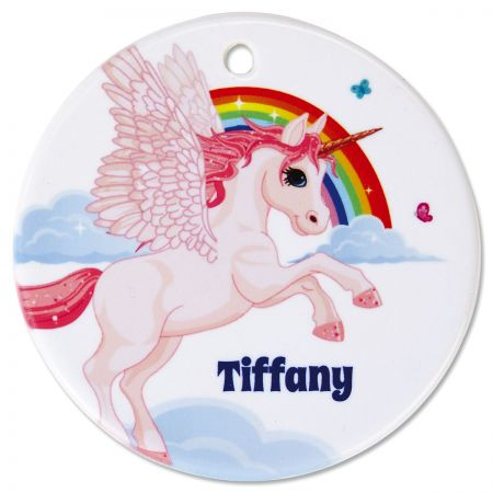 Round Personalized Unicorn Ceramic Ornament She'll fly over the rainbow when she sees her own unicorn and her own name on this small but expressive decor piece. Personalized ornament hangs in a window or pins to a bulletin board. Everyday ceramic ornaments are fun for children, teens, and adults. This round ornament: Measures 2-3/4  in diameter Is printed and personalized on one side Includes ribbon you can attach for hanging Features beautiful custom lettering Wipes clean with a damp cloth Specify 1 line up to 12 characters