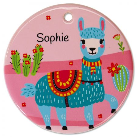 Round Personalized Llama Ceramic Ornament Every look takes you on a fast visit to the high-desert llama ranchwith your own name on this small but expressive decor piece. Personalized ornament hangs in a window or pins to a bulletin board. Everyday ceramic ornaments are fun for children, teens, and adults. This round ornament: Measures 2-3/4  in diameter Is printed and personalized on one side Includes ribbon you can attach for hanging Features beautiful custom lettering Wipes clean with a damp cloth Specify 1 line up to 12 characters
