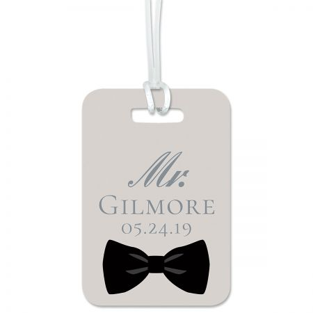 Bow Tie Personalized Luggage Tag Keep track of backpacks, suitcases and sports bags. 2 3/4 x 4  plus strap. Specify line 1 up to 10 characters, line 2 up to 15 charaters, line 3 up to 18 characters, and lines 4-6 up to 20 characters each.