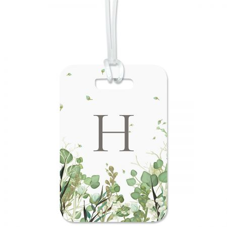 Leaves Personalized Luggage Tag Keep track of backpacks, suitcases and sports bags. 2 3/4 x 4  plus strap. Specify 1 initial, line 1 up to 10 characters, and lines 2-4 up to 18 characters each.