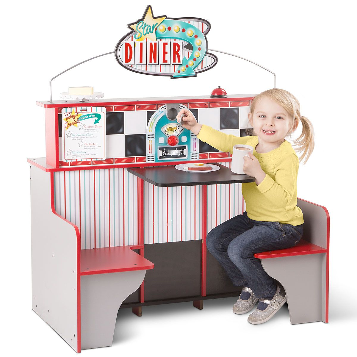 Melissa & Doug's Star Diner Restaurant Double-sided play space provides double the fun. On the kitchen side, kids can make believe they're cooking and serving at their own restaurant, while on the booth side, young customers can order and enjoy a pretend meal. Kitchen features oven, stovetop and grill, 2-shelf refrigerator, drink dispenser, and milkshake mixer. Booth side includes 2 seats and a jukebox with a spinning dial that lets them choose their favorite tunes. A coin is included for small music lovers to drop in the jukebox slot. Also includes Star Diner sign with clips on one side to hold orders. Large enough for several kids to play at once, the assembled set measures 23  x 43-1/2  and 35  high. Play space is made of wood for sturdy service over years of play. Adult assembly needed. Ages 3+. Standard shipping only. Expedited shipping not available. Cannot be sent outside the 48 contiguous states, or to P.O. Box, APO/FPO, or foreign addresses.